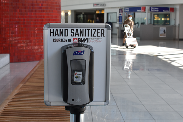 hand sanitizer station inside airport terminal
