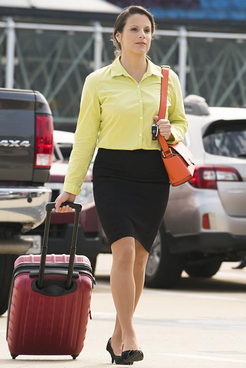 Woman walking from her car to the terminal